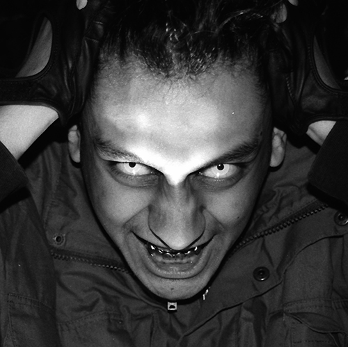 Black And White Photographic portrait featuring fangs and contact lenses by Broken Babies titled Faces Of Terror 5 of 9